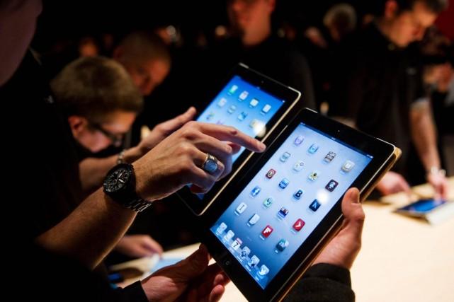 Apple affirme dans les conditions d'utilisation de l'iOS... (Photo archives AFP)