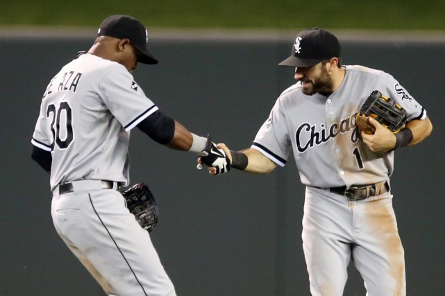 Adam Eaton, à droite, et Alejandro De Aza... (Photo Jim Mone, Associated Press)
