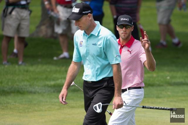 L'Américain Jim Furyk et le Canadien Graham DeLaet... (Photo Robert Skinner, La Presse)