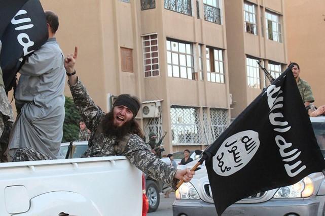 Des djihadistes de l'État islamique dans la province... (PHOTO ARCHIVES AFP/WELAYAT RAQA)