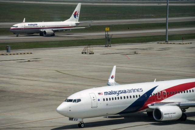 Un avion de Malaysia Airlines... (PHOTO MOHD RASFAN, archives AFP)