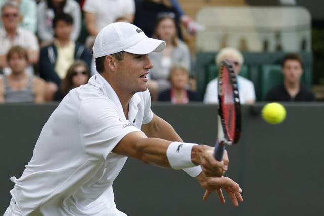 Le favori et champion en titre John Isner... (Photo ANDREW COWIE, Archives AFP)