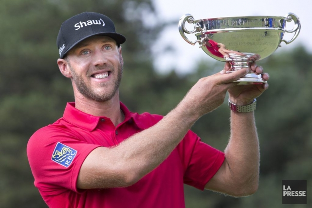 Graham DeLaet a remporté dimanche le trophée du... (Photo: Robert Skinner, La Presse)