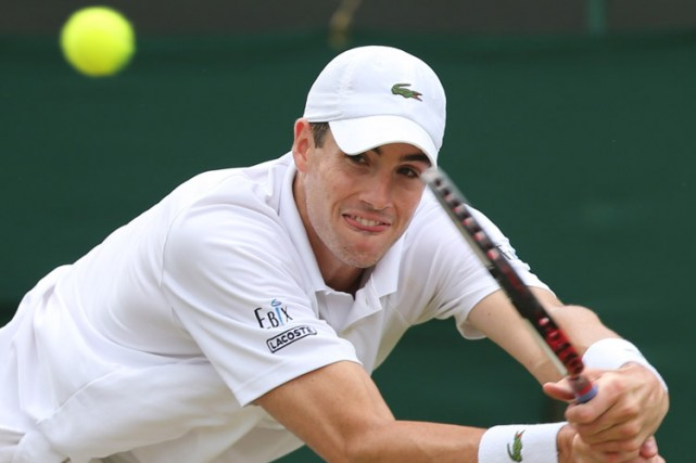 John Isner... (Archives AFP)