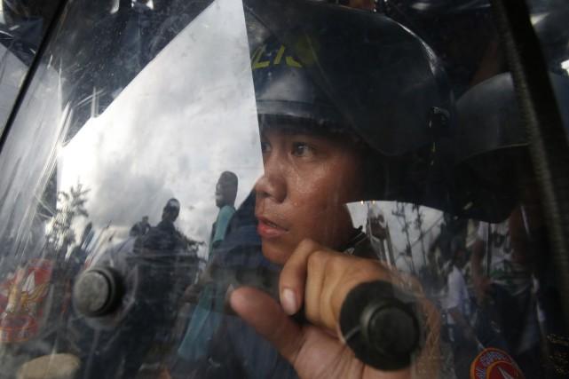 Des militants islamistes philippins du groupe Abu Sayyaf ont massacré 21... (Photo ERIK DE CASTRO, REUTERS)