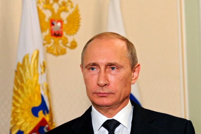 Le président de la Russie Vlaidmir Poutine.... (PHOTO MIKHAIL KLIMENTYEV, ARCHIVES AGENCE FRANCE-PRESSE)