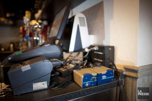 Le module d'enregistrement des ventes (MEV) est un... (Photo André Pichette, archives La Presse)