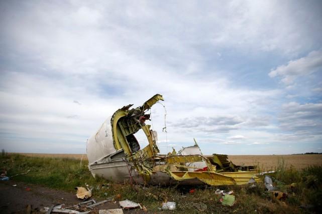 Des débris du vol MH17,abattu par un missile... (Photo Maxim Zmeyev, Archives Reuters)