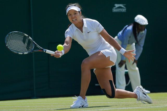 Li Na souffre d'une blessure à un genou.... (Photo Pavel Golovkin, archives AP)