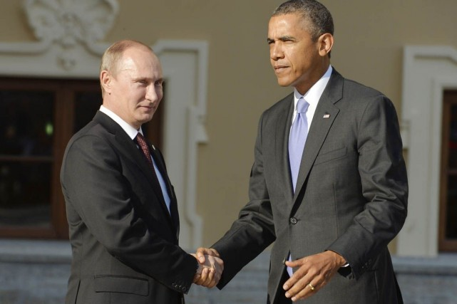 Vladimir Poutinea souligné auprès de son homologue américain... (PHOTO ERIC FEFERBERG, ARCHIVES AFP)