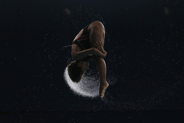 Jennifer Abel of Canada dives during the women's... (PHOTO STEFAN WERMUTH, REUTERS)
