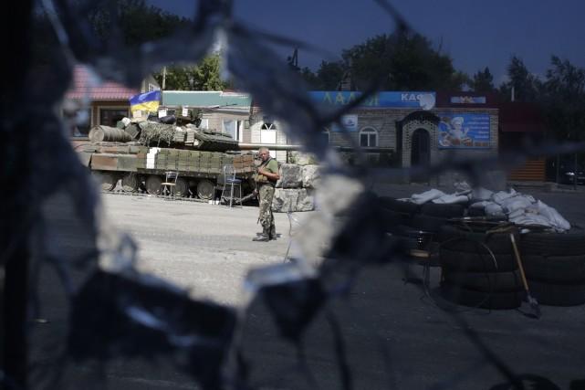 Au total, les affrontements dans l'est de l'Ukraine... (Photo ANATOLII STEPANOV, AFP)