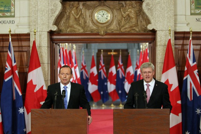Sous Tony Abbott, l'Australie rejoint le Canada de... (Photo Cole Burston, AFP)
