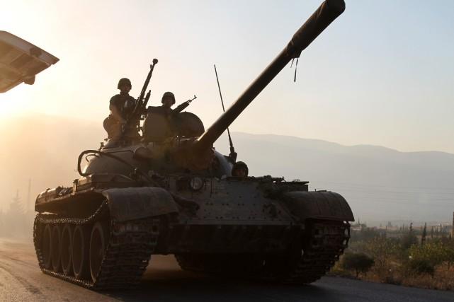 Au moins 32 personnes ont péri dimanche dans des raids de l'aviation syrienne... (Photo AFP)