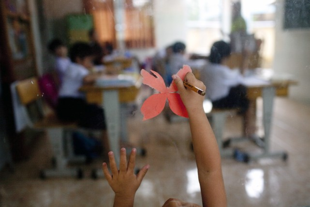 Deux Vietnamiennes, soupçonnées d'avoir vendu un enfant laissé aux soins d'un... (Photo JUSTIN MOTT, The New York Times)