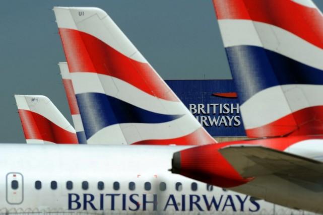 British Airways a annoncé mardi la suspension jusqu'au 31 août au moins de ses... (PHOTO ADRIAN DENNIS, ARCHIVES AFP)