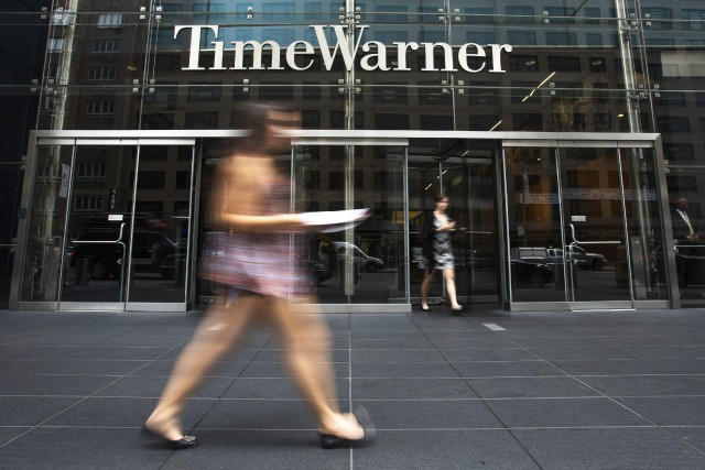 L'action de Time Warner progressait de 1,81% à... (PHOTO ARCHIVES REUTERS)