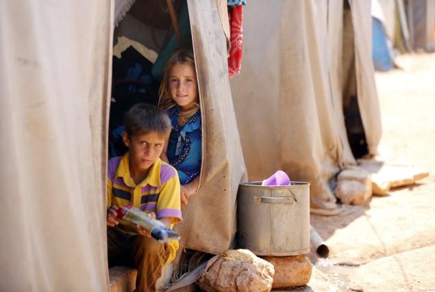 Human Rights Watch (HRW) a indiqué mercredi que des groupes armés syriens... (Photo REUTERS)