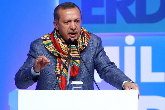 Le premier ministre turc et candidat à l'élection... (PHOTO ADEM ALTAN, AFP)