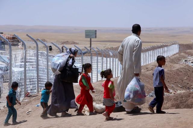 Ce nouvel exode dépasse largement par son ampleur... (Photo SAFIN HAMED, AFP)