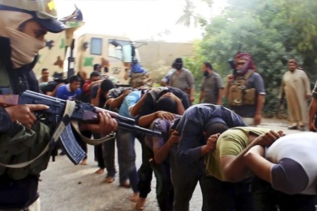 En juin dernier, des membres de l'État islamique... (Photo Archives AP)