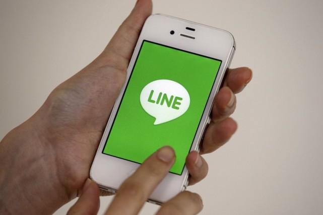 Le réseau social Line compte quelque 400 millions... (Photo Lee Jin-man, Archives AP)
