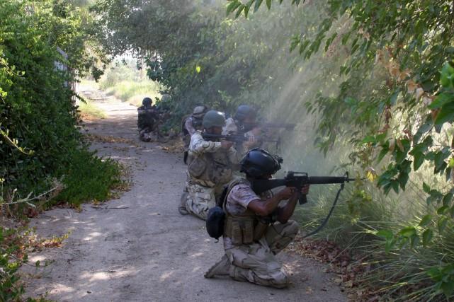 Les combats auraient fait une quarantaine de blessés,... (PHOTO AGENCE FRANCE-PRESSE)