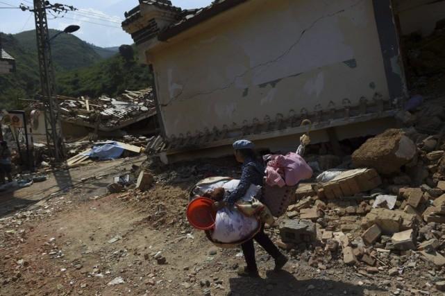 Le séisme de magnitude6,1 est survenu dimanche, dans... (PHOTO GREG BAKER, AFP)
