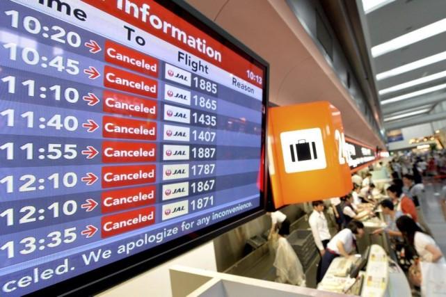 Au total 473 vols ont dû être annulés... (PHOTO KAZUHIRO NOGI, AFP)