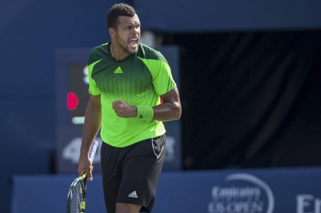 Jo-Wilfried Tsonga... (PHOTO GEOFF ROBINS, AGENCE FRANCE-PRESSE)