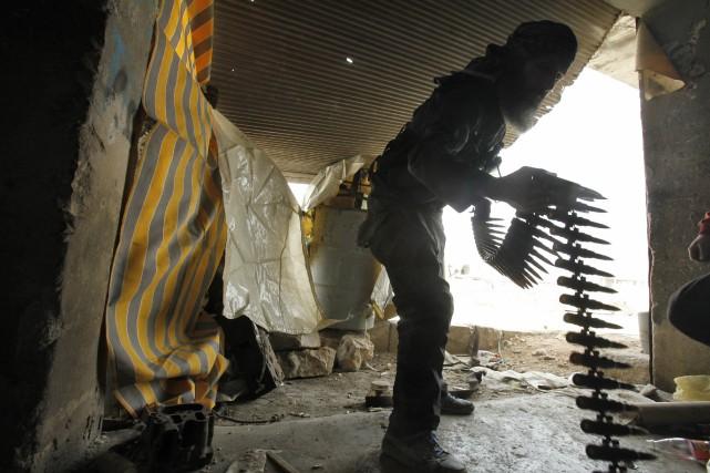 Londres va acheminer aux forces kurdes du «matériel militaire d'autres États... (Photo AMMAR ABDULLAH, Archives Reuters)