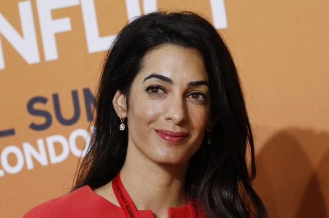 Amal Alamuddin, une juriste britannico-libanaise, fiancée de l'acteur américain... (Photo Lefteris Pitarakis, AP)