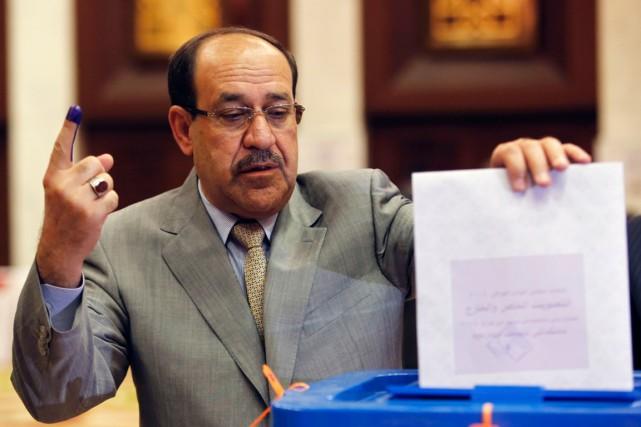 Nouri al-Maliki vote lors des législatives d'avril 2014,... (Photo Ahmed Jadallah, archives Reuters)