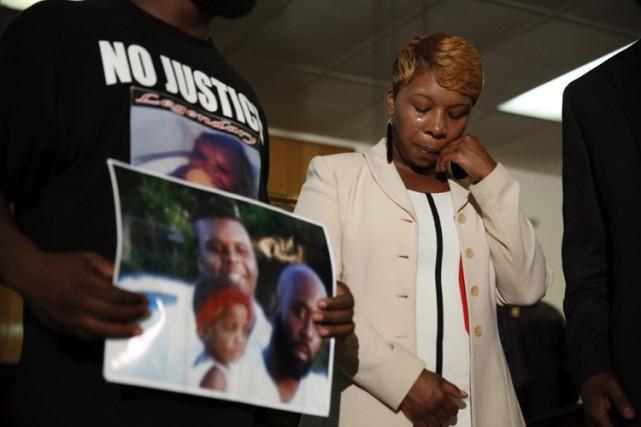«Pas de violence mais la justice», a réclamé... (Photo: AP)