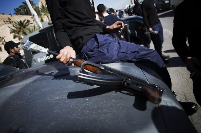 L'assassinat du chef de la police de Tripoli... (Photo Manu Brabo, AP)