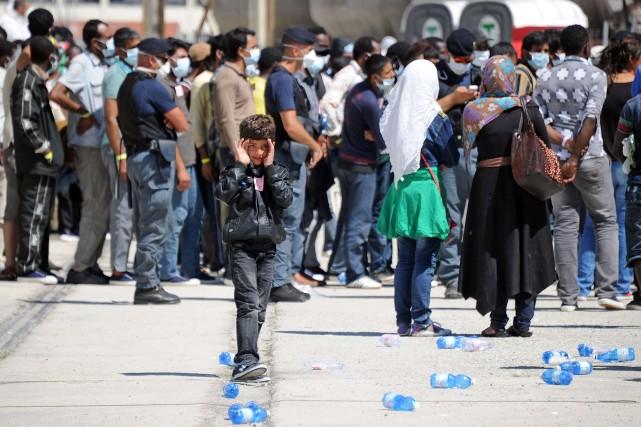 Les Érythréens et les Syriens constituent le gros... (Photo GIOVANNI ISOLINO, AFP)