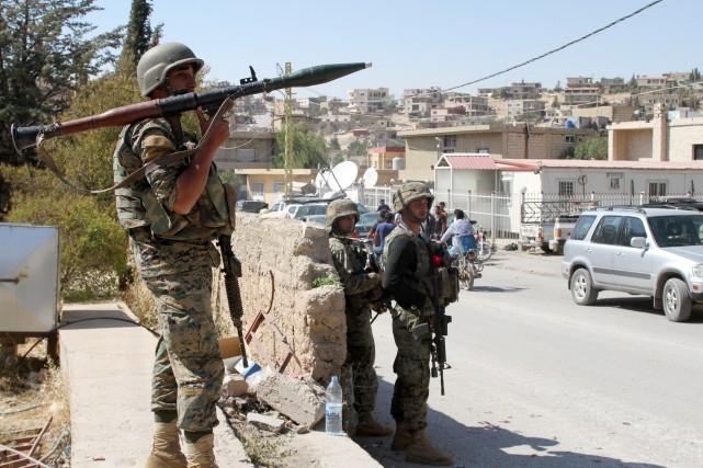 Les forces gouvernementales ont pris le contrôle total d'une localité clé dans... (Photo AFP)
