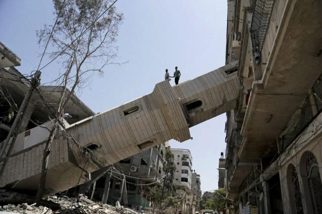 Le territoire dévasté goûtait samedi son sixième jour... (Photo Adel Hana, Associated Press)