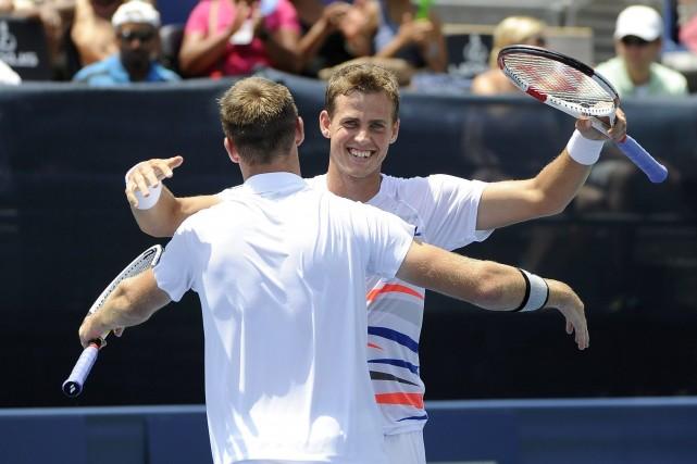 Vasek Pospisil et Jack Sock... (Photo David Tulis, archives AP)