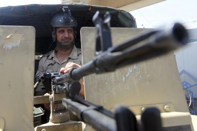 Les ministres américain et britannique ont assuré qu'ils... (PHOTO AMER AL-SAEDI, AFP)