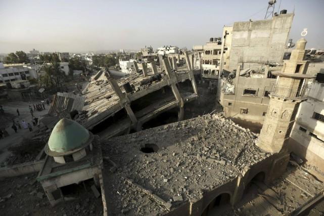 Une offensive israélienne lancée le 8 juillet contre... (PHOTO MOHAMMED ABED, AFP)