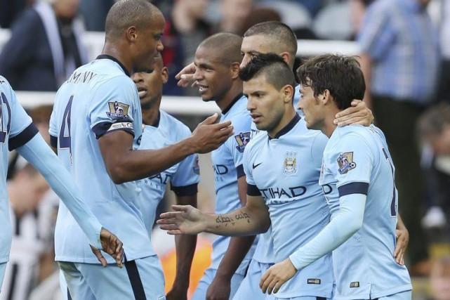 Manchester City et le Schalke 04 ont mis la main sur les dernières places... (PHOTO IAN MACNICOL, AFP)