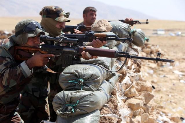 Les forces kurdes avaient lancé samedi une offensive... (Photo AHMAD AL-RUBAYE, AFP)