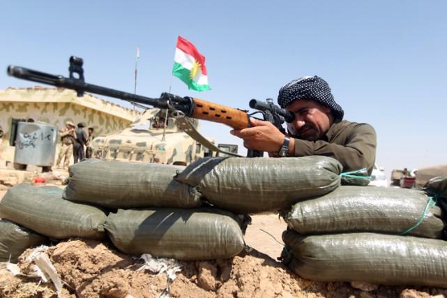 Aidées par ces frappes, les forces kurdes ont... (Photo: AFP)