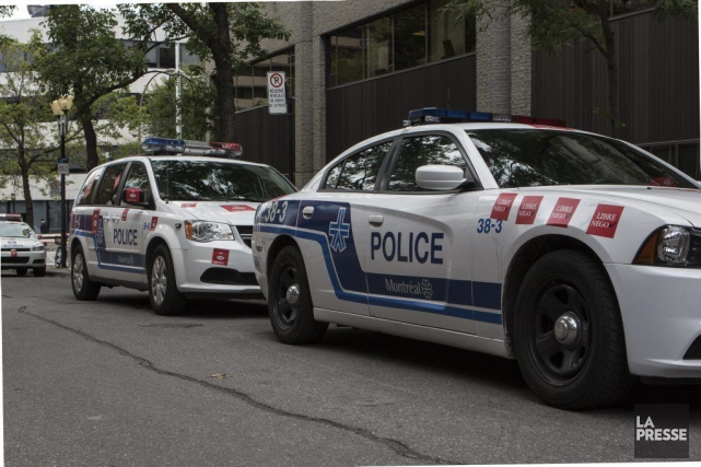 Montréal demande à son service de police de réduire le nombre de ses policiers... (PHOTO MATHIEU WADDELL, ARCHIVES LA PRESSE)