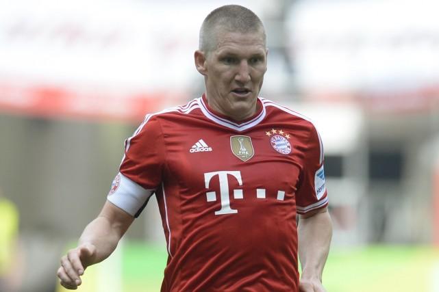 Le milieu de terrain Bastian Schweinsteiger souffre d'une... (Photo Christof Stache, archives AFP)
