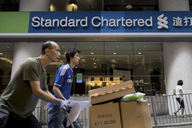 Standard Chartered va payer une amende de 300... (Photo Alex Ogle, Archives AFP)