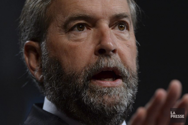 Thomas Mulcair, qui s'est adressé aux journalistes en... (Photo Sean Kilpatrick, PC)