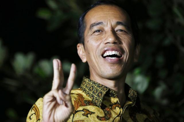 La victoire de Jokowi, issu d'un milieu modeste... (PHOTO DARREN WHITESIDE, REUTERS)