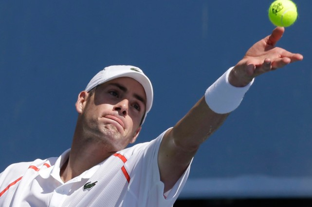 John Isner... (Photo Al Behrman, archives AP)